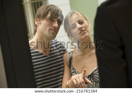 A couple window shopping. - stock photo