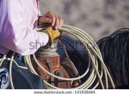 A cowboy waiting to compete in a rodeo - stock photo