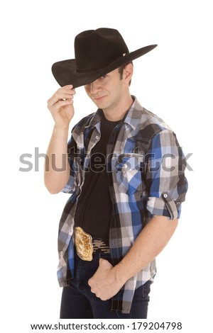 A cowboy with a big black hat on his head. - stock photo