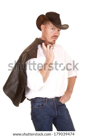 A cowboy with a smirk on his face holding on to his face - stock photo