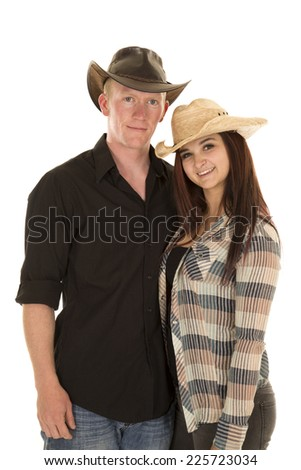 a cowboy with his cowgirl with smiles.