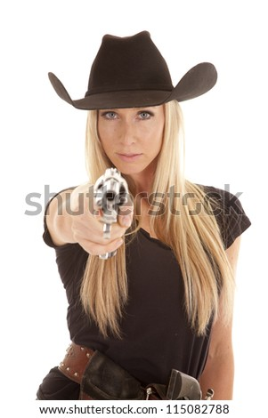 A cowgirl pointing her pistol at the camera with a serious expression on her face.