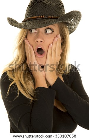 A cowgirl with a shocked expression on her face, looking to the side.