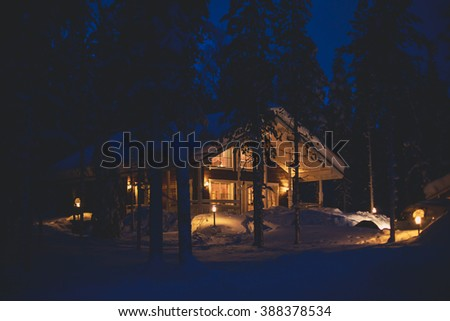 A cozy cottage chalet house near ski resort in winter - stock photo