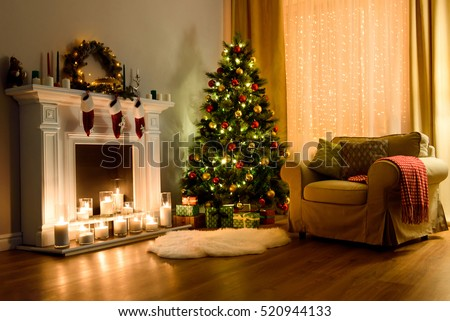 A Cozy Living Room Lighted With Numerous Lights Decorated Ready To Celebrate Christmas
