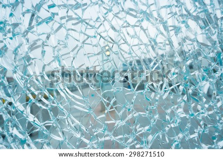 A cracked and broken glass. Shallow depth of field - stock photo