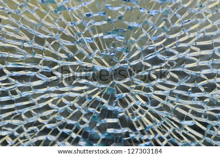 A cracked and broken glass window - stock photo