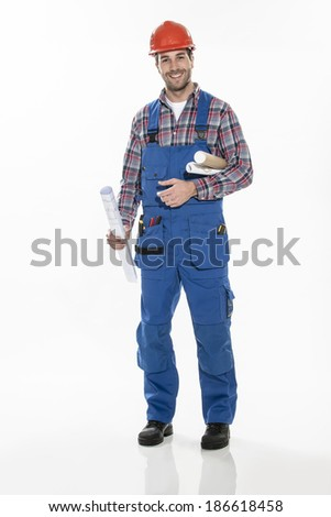 a craftsman in workwear clothing with an hardhat and blueprints in arm