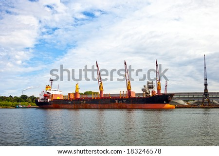 A crane ship on site working in port.