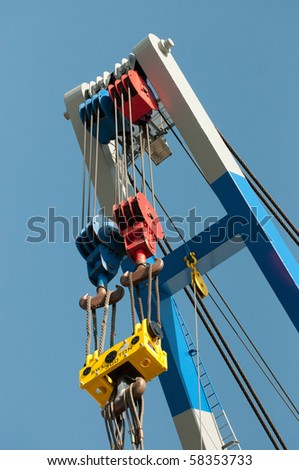 a crane with colorful hooks