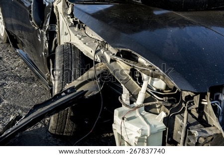 a crashed car with damage to the right front area. - stock photo