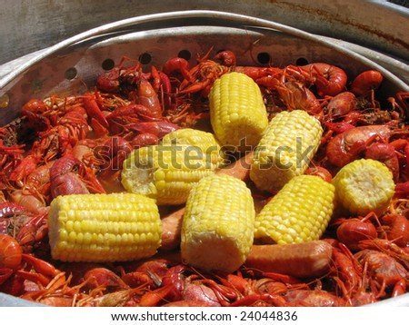 A crawfish boil in south Louisiana including crawfish, corn and sausage being cooked on an outdoor cooker. - stock photo