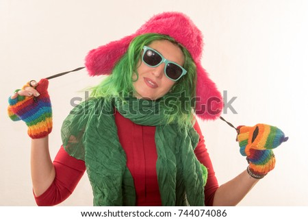a crazy caucasian girl trying on various hats for the christmas fun carnival the concept