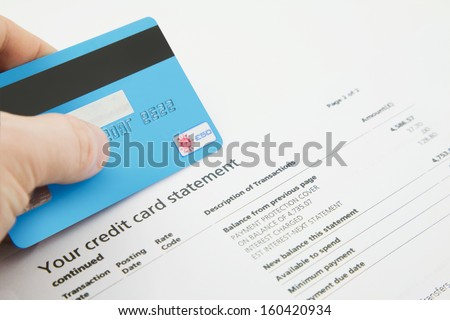 A Credit Card on top of a fake Bank Statements - stock photo