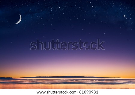 A crescent moon and stars over an island in the Pacific ocean just after sunset.