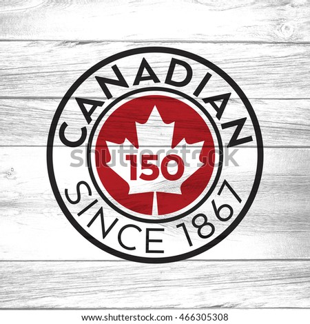 A crest celebrating Canada's one hundred and fifty years of confederation on a background of distressed barnboard.