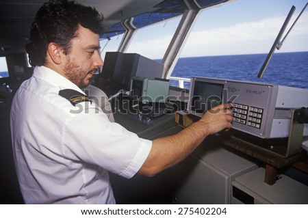 A crew member of the ferry Bluenose piloting the ship through the waters between Maine and Nova Scotia - stock photo