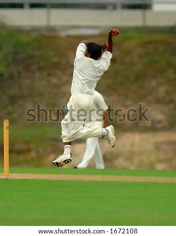 A cricket bowler ready and jumping to bowl - stock photo