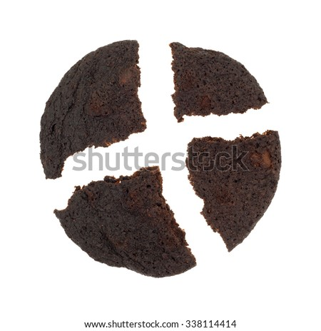 A crispy chocolate chip brownie cookie broken into four pieces on a white background. - stock photo
