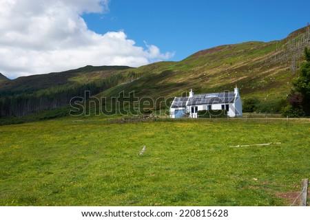 A Croft at Loch Gleann Bharcasaig, Orbost near Dunvegan on the Isle of Skye. - stock photo