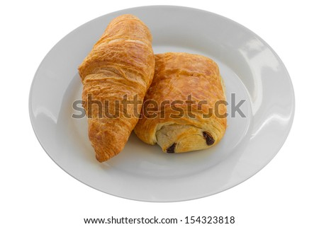 A Croissant and a Pain au Chocolat on a White Plate Isolated on a White Background - stock photo