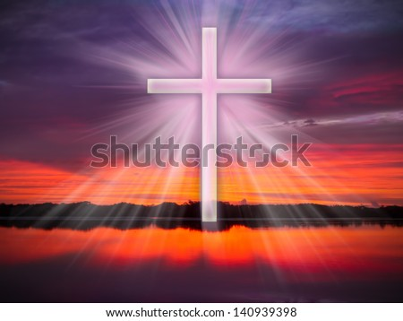 A cross in the sky over a river or ocean with light rays at sunrise or sunset. - stock photo