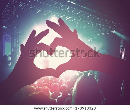 a crowd of people at a concert done with a retro vintage instagram filter  - stock photo