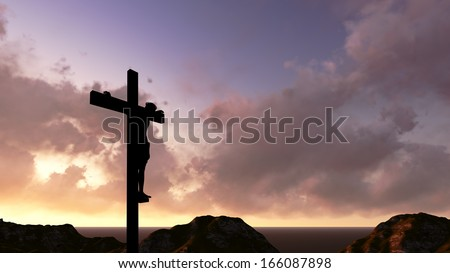 A crucifix silhouette set against a dramatic sky. - stock photo
