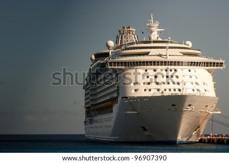 A cruise ship docked with passengers disembarking - stock photo