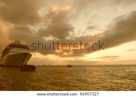 A cruise ship in port at sunset