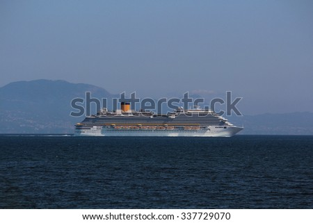 A cruise ship on the sea - side view