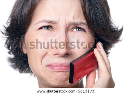 A crying girl with a mobile phone - stock photo