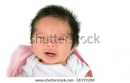 A crying newborn baby girl on a white background