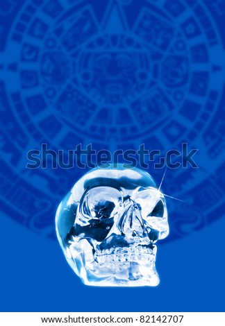 A crystal skull shown against a backdrop of the Mayan calander