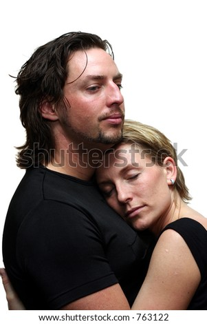 A cuddling couple isolated on white - stock photo