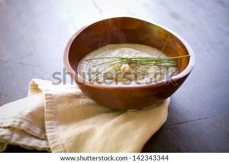 A cumin infused vegetarian cauliflower puree in a bowl. - stock photo