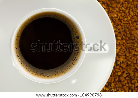 A cup full of coffee, on the basis of instant coffee. - stock photo
