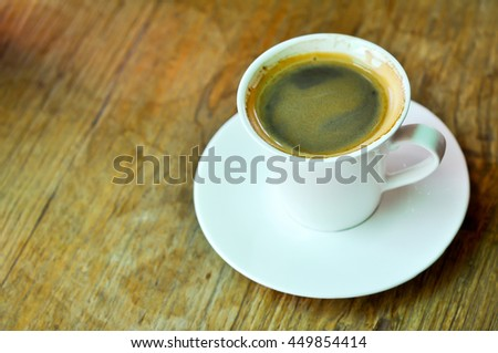 A cup of americano coffee on the table. - stock photo