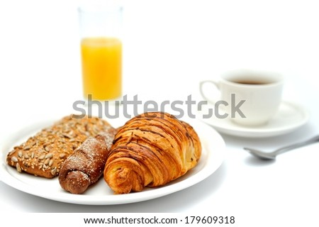 A cup of black coffee, breakfast bread and a glass of orange juice