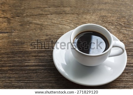 A cup of black coffee on wooden - stock photo