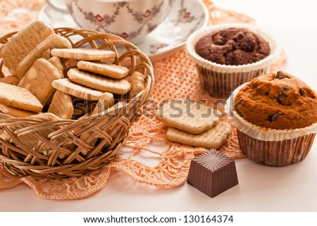 A cup of black tea and cookies on a plate with  sweet - stock photo