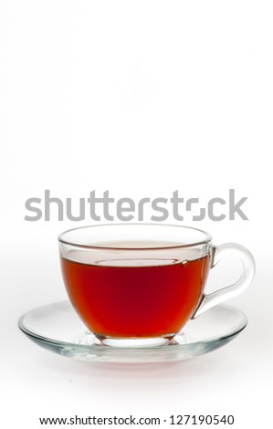 A cup of black tea on a white background - stock photo