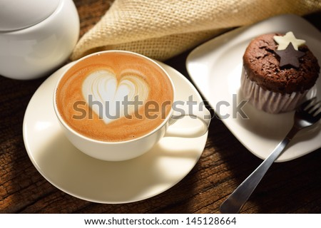 A cup of cafe latte and cake - stock photo