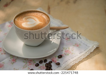 A cup of cafe latte with heart shape - stock photo
