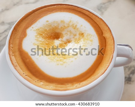 A cup of cappuccino on the marble table