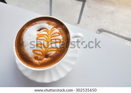 A Cup of Cappuccino with Froth, A Cup of Cappuccino with Froth in coffee shop - stock photo