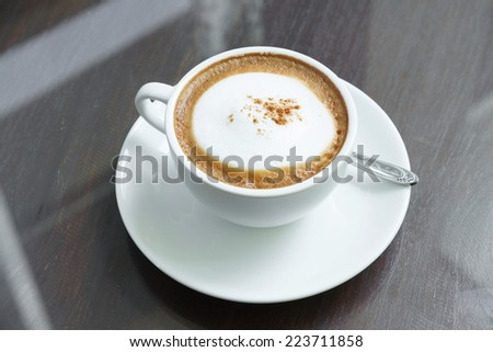 a cup of Capuchino coffee - stock photo