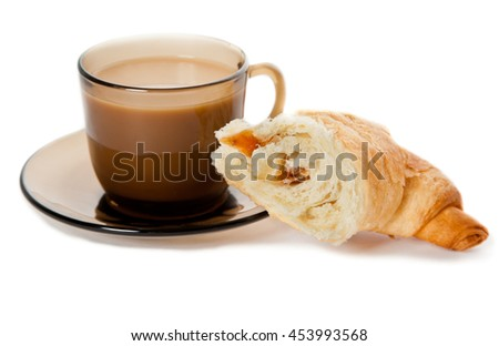A cup of coffee and a cornetto - stock photo