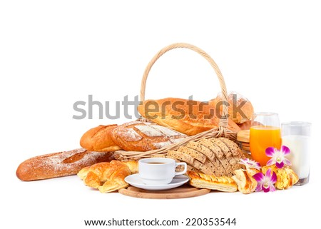 A  cup of coffee and a Glass of milk and Orange juice with flour and bread in basket on wood block and white background - stock photo