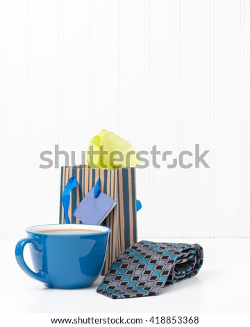 A cup of coffee and a new tie are great gifts for dad. - stock photo